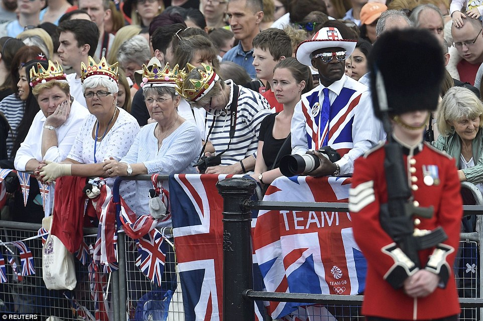 A royal good time: Fans are dressed in crowns and Union Jack-themed clothes to show their support for the monarch