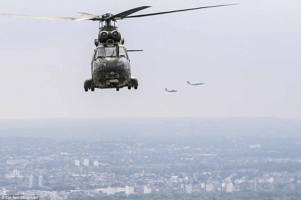 Chopper: A RAF Chinook helicopter flies over London towards Buckingham Palace as part of the fly-past for the birthday celebration