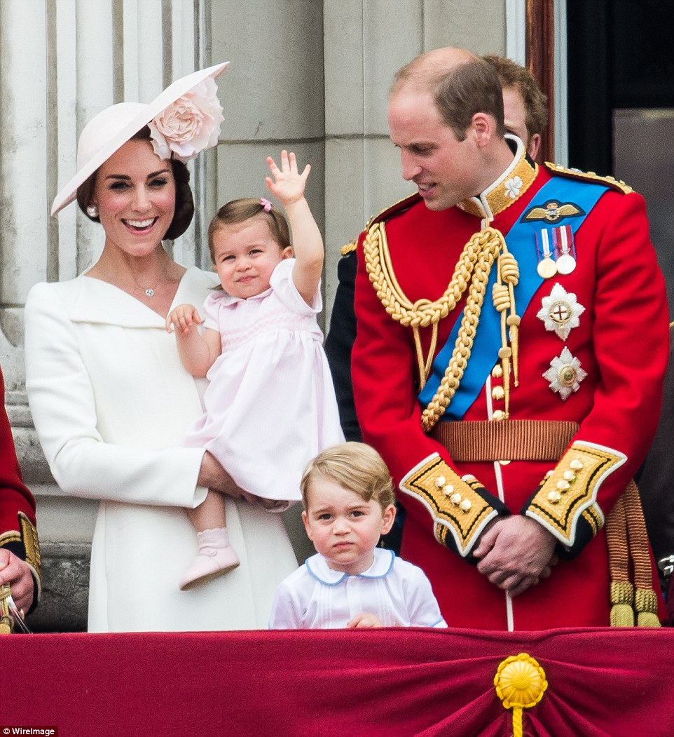 First of many: Princess Charlotte, pictured with father Prince William, right, brother Prince George, centre, and mother the Duchess of Cambridge, left, delighted people across the globe when she performed her first royal wave from Buckingham Palace