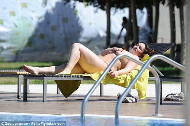 Soaking up the sun: She reclined and closed her eyes as she enjoyed a relaxing lie down