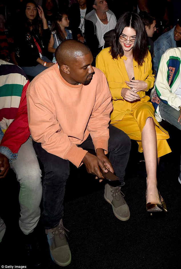 Family bonding: Kanye and Kendall chat in the front row as they wait for the show to start