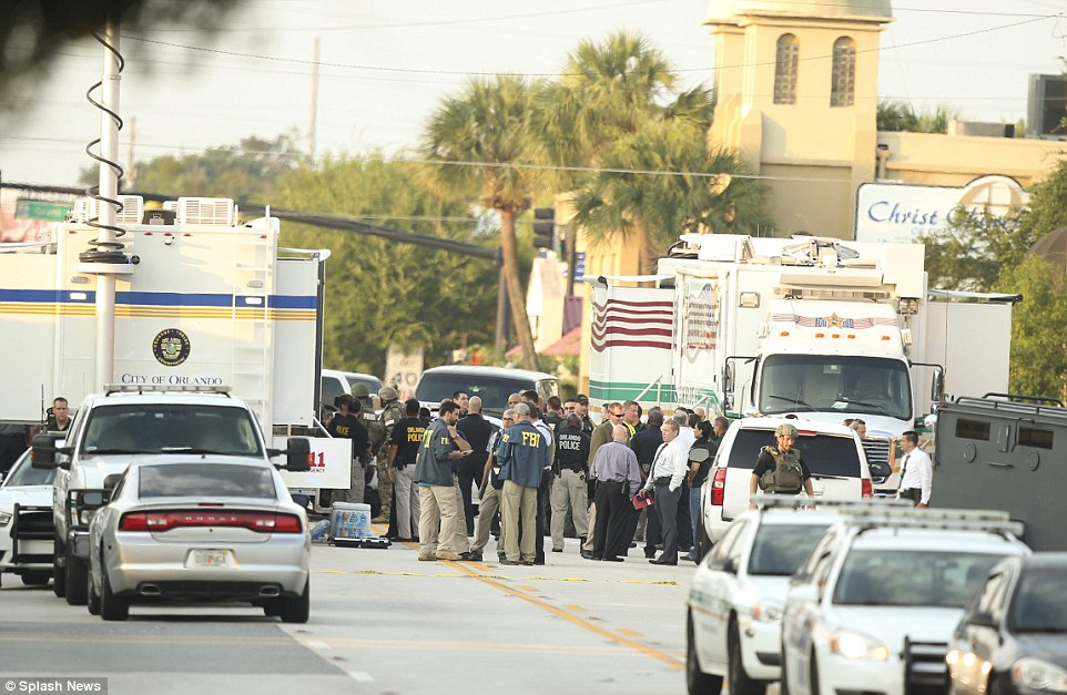 Police, army and FBI surround the club after a suspected Islamic extremist wielding an assault rifle and a handgun killed about 50 people