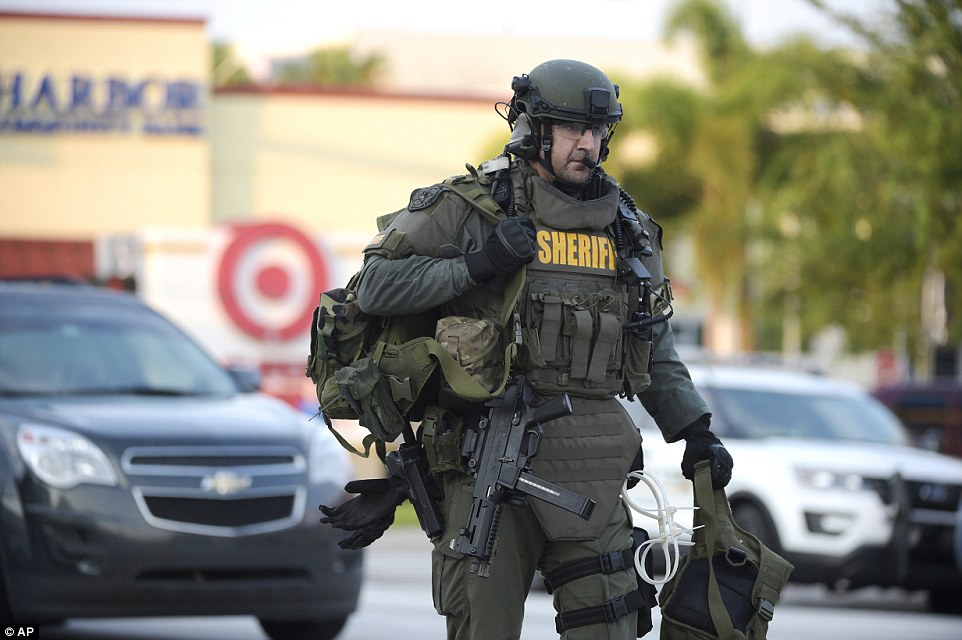 Fatalities: At least 50 people were killed and 53 others were injured in the shooting. Pictured:An Orange County Sheriff's Department SWAT member