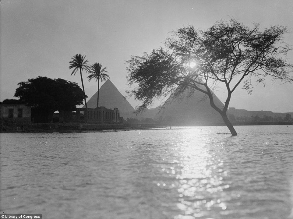 This photograph, taken while the Nile has flooded its banks around 1900, shows a tree partially submerged and the waters getting precariously close to the temples in the foreground