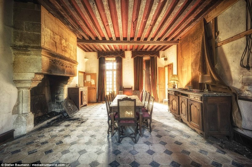 This chateau in France has been abandoned for more than 10 years. The family was unable to afford the costs of renovating and fixing the the residence, although this room carries a lot of promise with its impressive fireplace and huge windows that let the light flood in