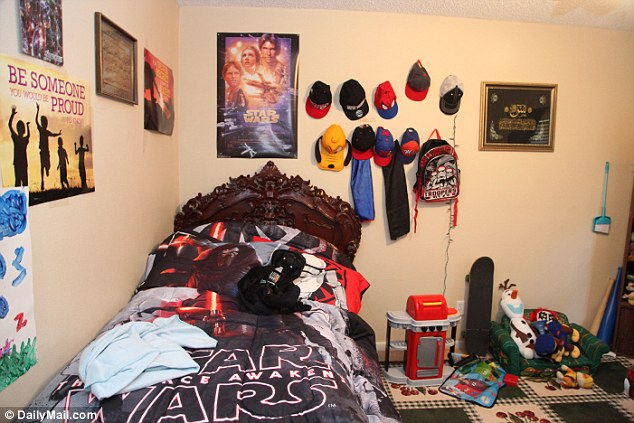 Star Wars bedding and posters adorn the walls of Mateen's son's bedroom along with baseball hats and a Ninja Turtle backpack