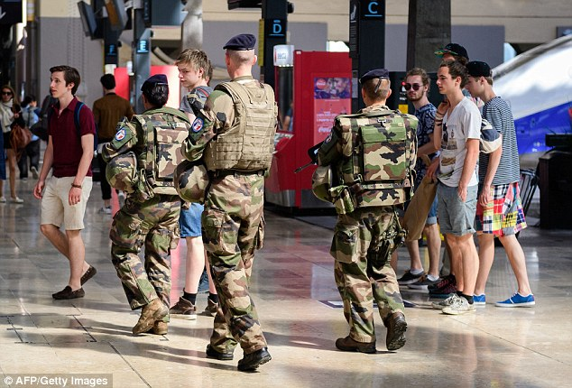 Security forces patrol in and around the gare de Marseille-Saint Charles train station for Euro 2016
