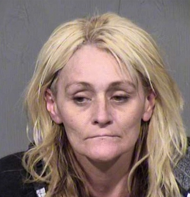 Misty Lee Wilke, 43, of Phoenix (pictured) has since been jailed following the incidednt, which the man survived but was left suffering a fractured vertebra and a head injury requiring staples