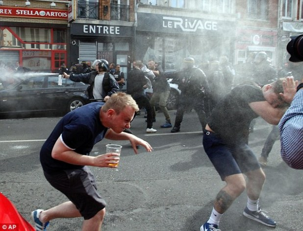 English fans could be seen sprinting for cover after pepper spray was fired by French police during scuffles in Lille