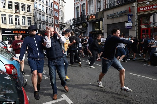 Trouble brewing: French riot police fired tear gas and baton charged England fans as they rampaged through the streets of Lille today