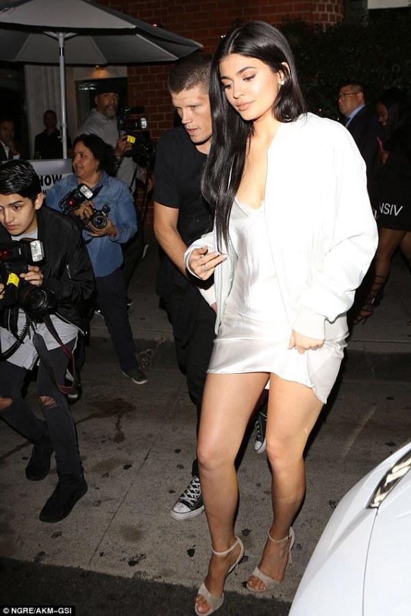 Kylie Jenner looks leggy in silk slip dress as she hits ...