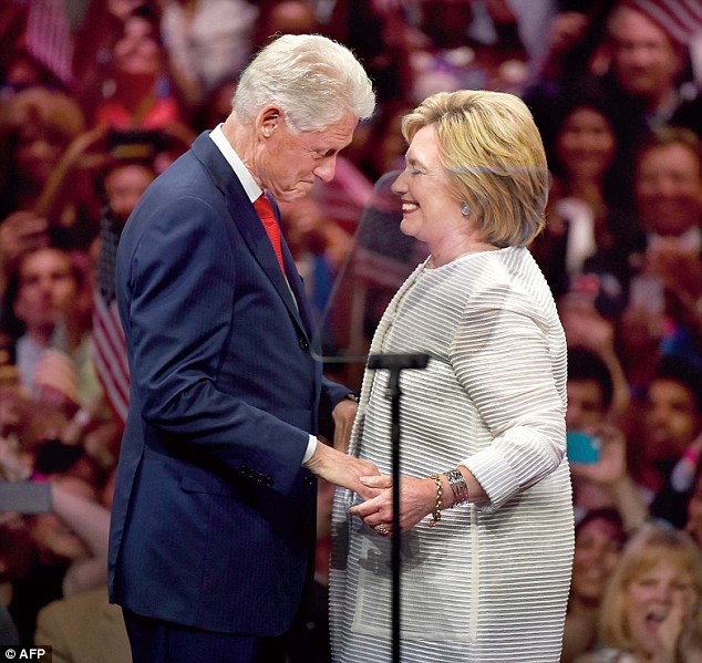 Dolly says Hillary (pictured with Bill on Tuesday) was caught on record blurting out the terms 'stupid k**e' and 'f***ing Jew bastard', while Bill called the Reverend Jesse Jackson a 'G**damned n****r'