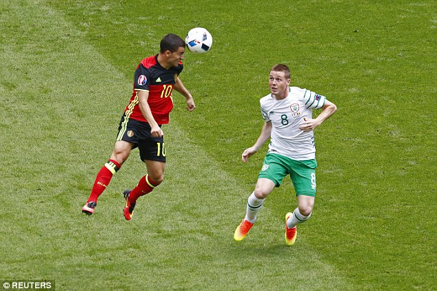 The game between Belgium and Ireland (pictured, with Belgium in the red kit) has now kicked off in Bordeaux and security is high in the Belgian capital, especially around the fanzone