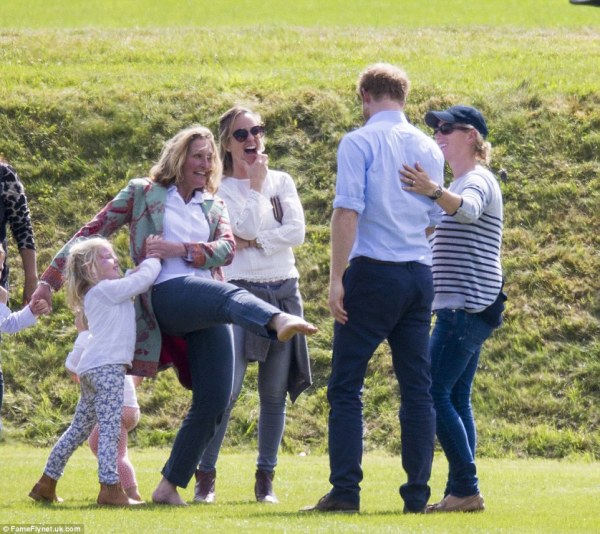 Prince Harry cheers up Mia Tindall at Beaufort Polo Club ...