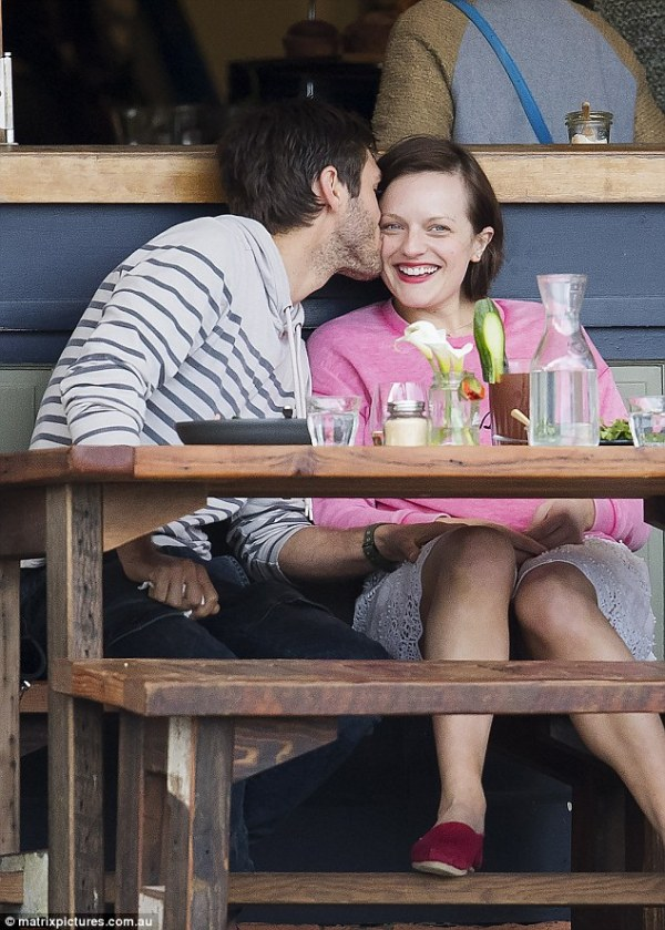 Elisabeth Moss gets cosy with mystery man while filming ...