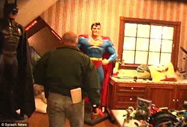 Life size: Jackson filled his home with life-size mannequins and superheroes like Superman (above)