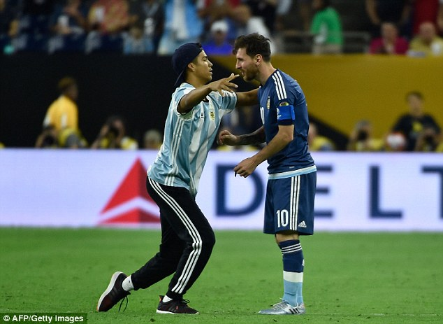 Before the second half resumed, a fan ran on to the pitch to embrace Argentina's diminutive genius