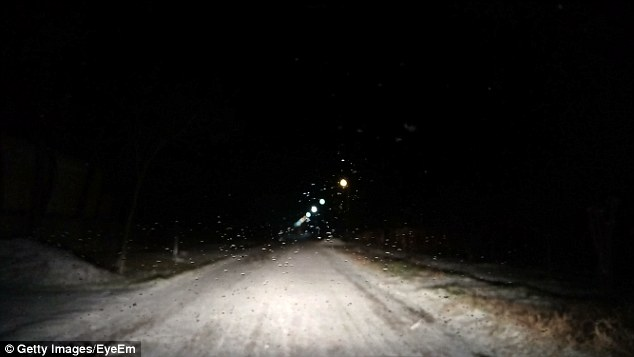 Drivers in Muscatine County, Iowa have been spotting men in black trench coats approaching their cars in the middle of the night (file photo of dark country road above)