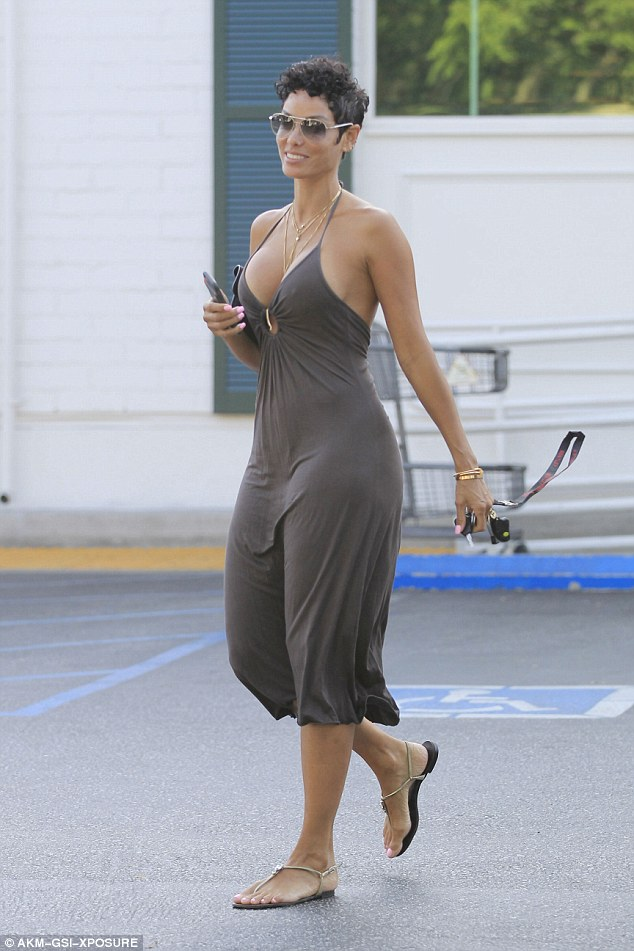 Nicole Murphy Puts Her Assets On Display In Plunging Maxi