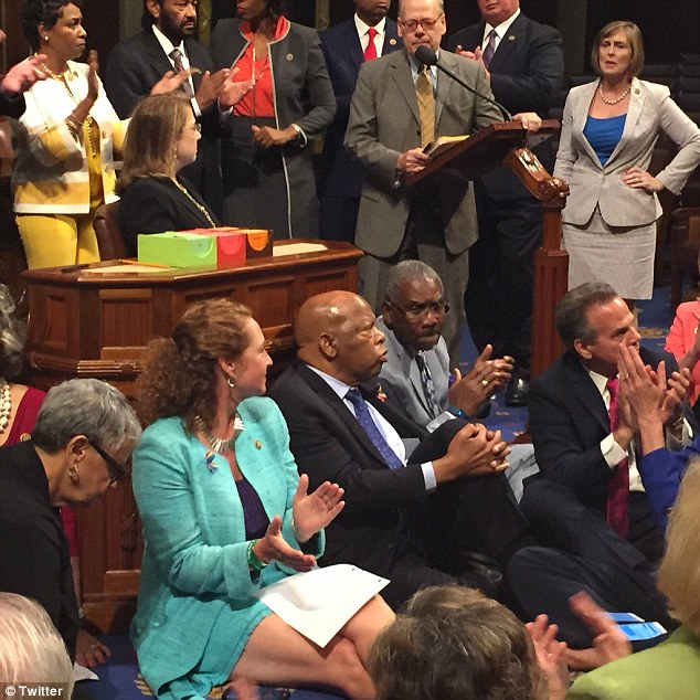 John Lewis was joined by several dozen of his Democratic colleagues who sat on the floor or stood in the well. Republicans responded by first taking a lunch break and then with calling a recess