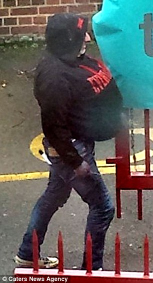 Disguise: Babur Raja was caught on CCTV with a knife in his back pocket shortly before trying to kill a woman in March this year