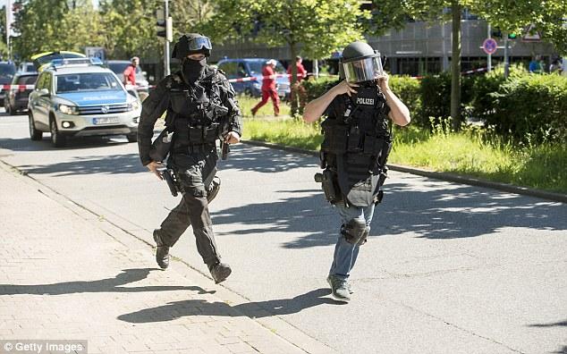 A gunman has been shot dead after opening fire inside a cinema in Western Germany
