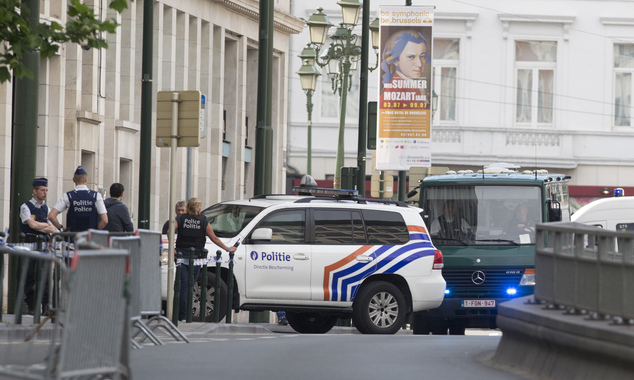 Vans and a police escort arrive for a court hearing for suspect Mohamed Abrini at the Court of Appeals in Brussels on Thursday