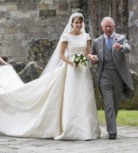 Prince Charles leads bride Alexandra Knatchbull, the daughter of his close friend Norton Knatchbull, who holds the title of Lord Brabourne, into Romsey Abbey in Hampshire