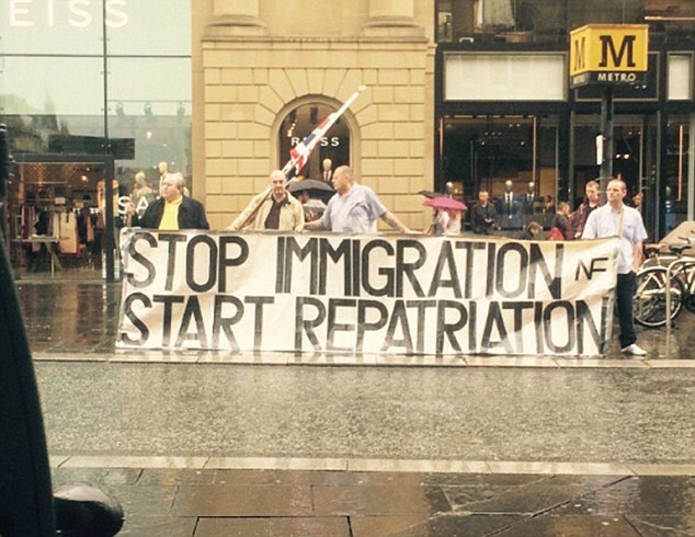During a rally in support of migrants in Newcastle yesterday, supporters of the old National Front displayed a banner declaring: 'Stop immigration. Start repatriation.'