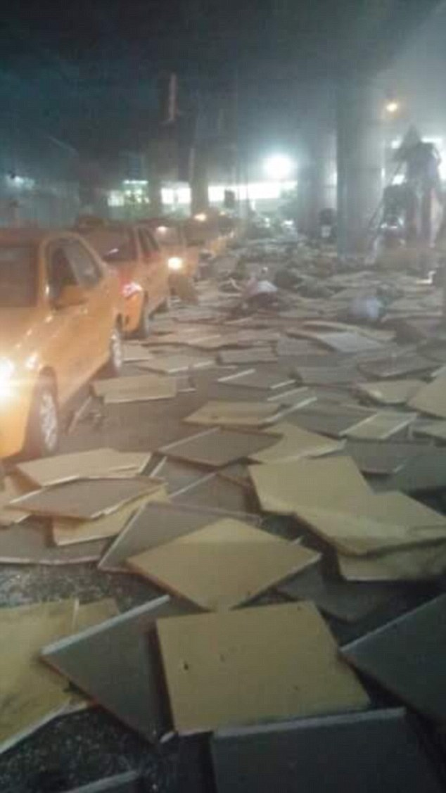 The first images to emerge from the scene show debris, including what appear to be ceiling tiles, scattered over taxis