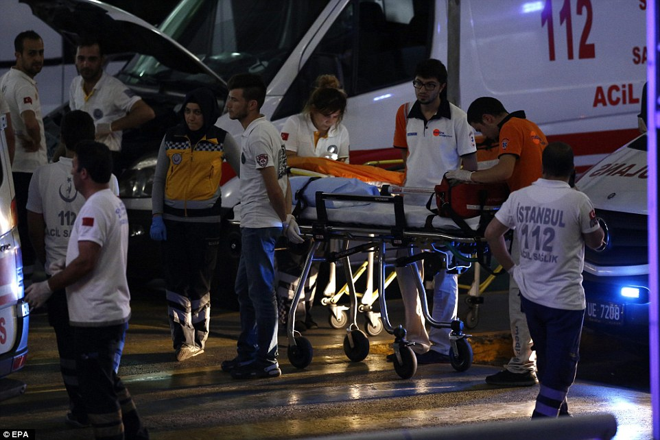 Dozens of paramedics help the wounded following the airport attack, which left at least 60 wounded and at least 10 dead