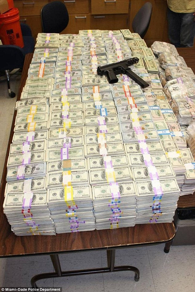 Miami police have seized a record $24million in cash from a drugs raid. Officers have said it is their biggest bust in history