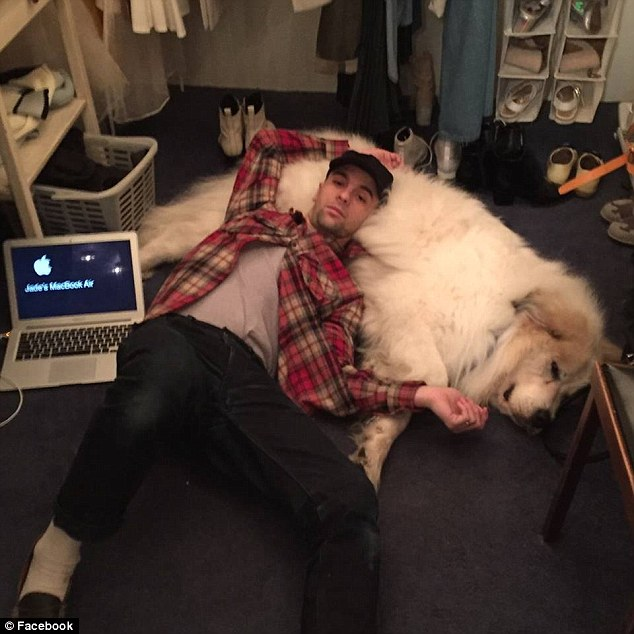 Mallory is seen lying on his huge dog in this photo uploaded to his Facebook account