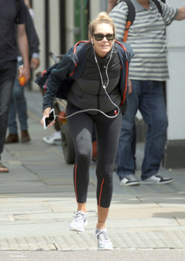 Elle Macpherson Stumbles As She Goes Jogging In London
