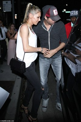 Intimate moments: On Friday evening tennis ace Anna Kournikova, 35, and long-time boyfriend Enrique Iglesias, 41, enjoyed a date night at The Palm restaurant in Beverly Hills