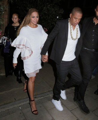 Crazy in love: Beyoncé, 34, celebrated her triumphant Wembley Stadium performance in style by visiting Harry's Bar, London, with husband Jay-Z, 46