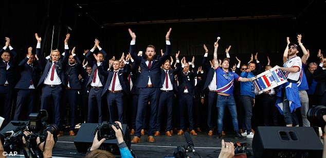Iceland players carry out their now world famous Viking clapping chant on Monday evening in Reykjavik