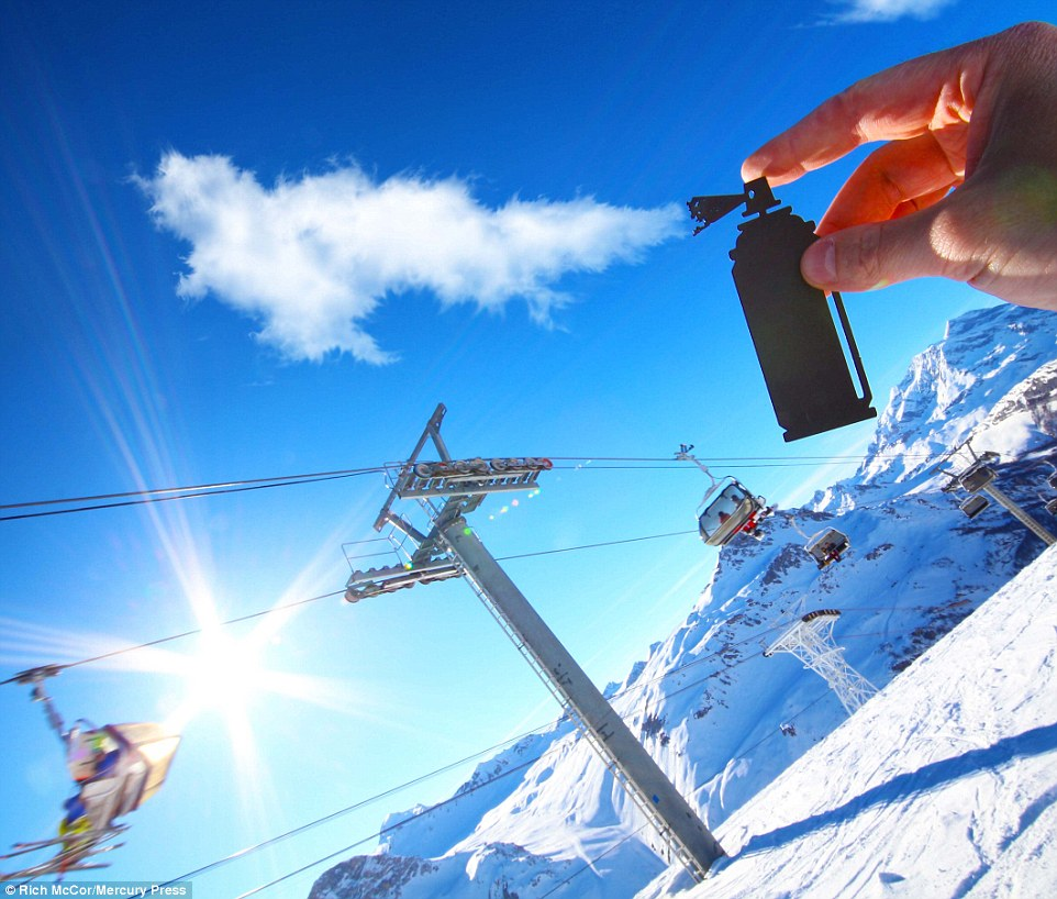 Taking to the slopes in Val D'Isere, Rich placed a spray can next to a cloud - with mesmerising results