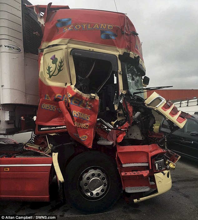 The front of the truck that was mangled by the ambush set by migrants near Calais, in northern France