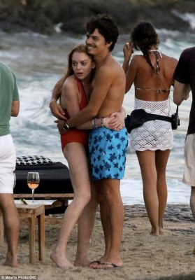 Loved-up: After celebrating her 30th birthday with a big meal on Monday, the Mean Girls star decided to top-up her tan, and made her way onto the sands with fiancé, Egor Tarabasov