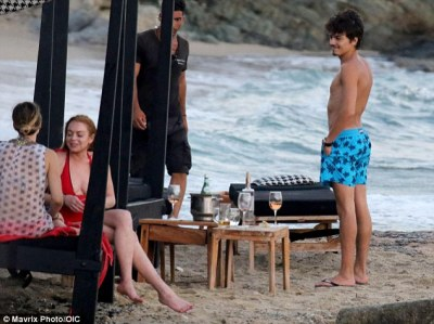 Beau on the beach: Egor, the son of Russian millionaire Dmitry Tarabasov, kept things casual in a pair of blue patterned swimming shorts