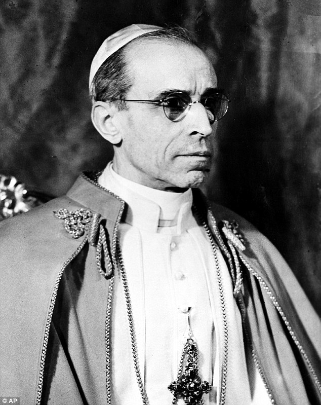 Pope Pius XII, robed in white with a scarlet cloak, is shown in Vatican City, was the target of an SS Commando kidnapping plot and would have had to be hidden for two to three days until the arrival of a special allied commando squad who would parachute into the countryside near Rome to come and rescue him