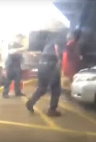 Shocking footage - taken from inside a car just a yard away - shows Sterling being wrestled and thrown on to the ground by officers who then hold him down as he attempts to struggle. Gun shots are then heard