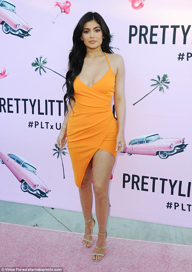 All eyes on her:Kylie Jenner made a bold statement in a tangerine frock at the US launch for clothing retailer PrettyLittleThing