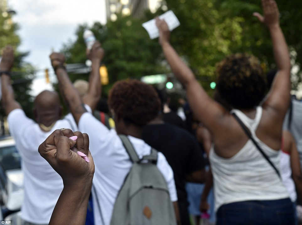 'Hands up don't shoot': Demonstrators march through downtown Atlanta to protest the shootings of two black men by police officers