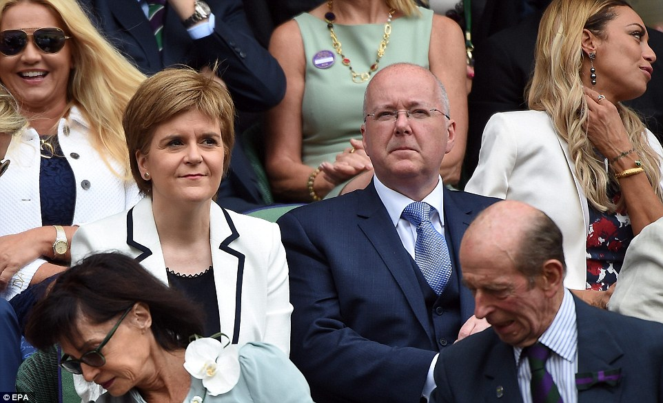 Scotland's First Minister Nicola Sturgeon, left, was also at Wimbledon to cheer on her fellow countryman with husband Peter Murell, right