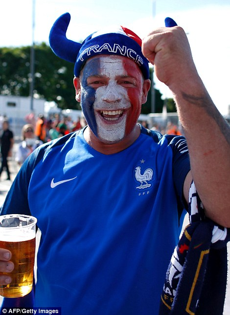 Having fun: A France supporter cheers as he arrives at the Stade de France in Saint-Denis