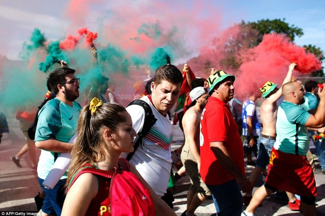 Party atmosphere: Portugal supporters wave smoke flares as they arrive at the Stade de France in Saint-Denis prior to the Euro 2016 final