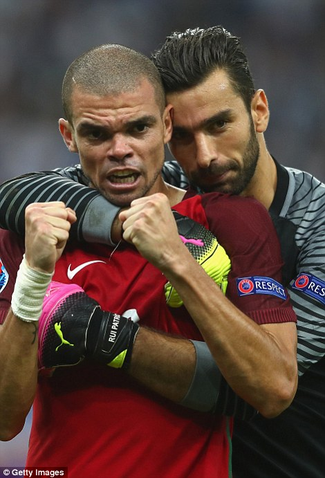 Defender Pepe and goalkeeper Rui Patricio embrace at the final whistle