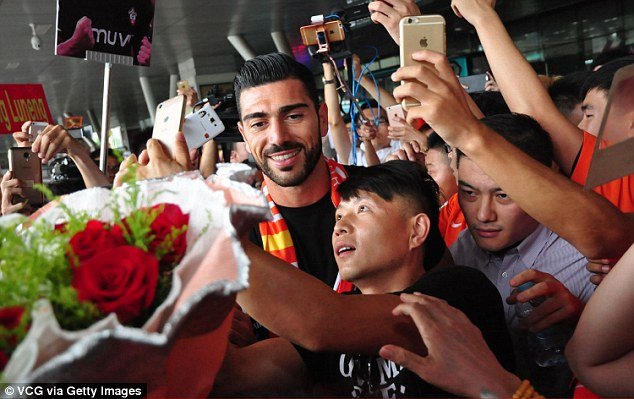 Pelle (left) was given a rapturous reception byShandong Luneng supporters on Tuesday at the airport